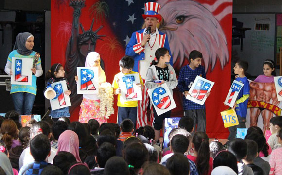 children participate onstage at school show for patriot's day